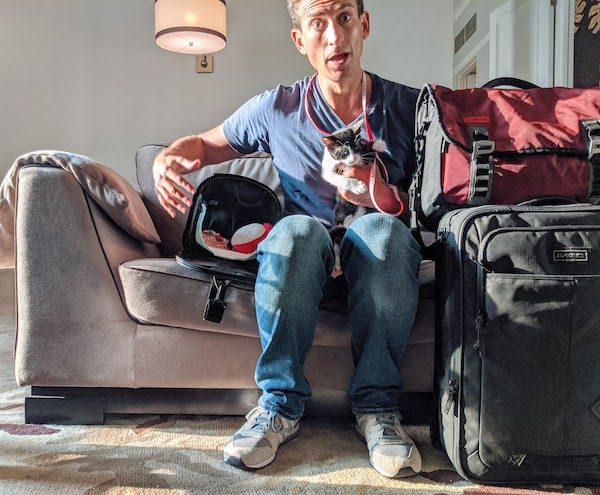 Derek Earl Baron of Wandering Earl with his cat Matcha