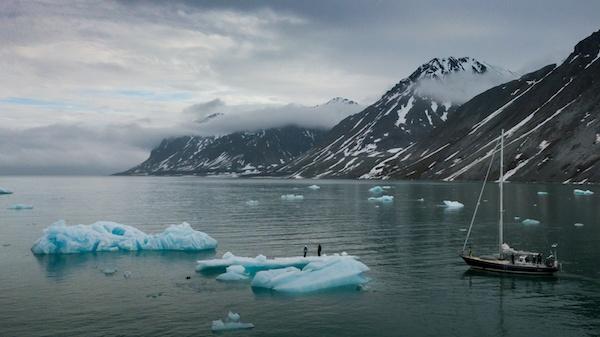 Sailing around Svalbard, standing on an iceberg