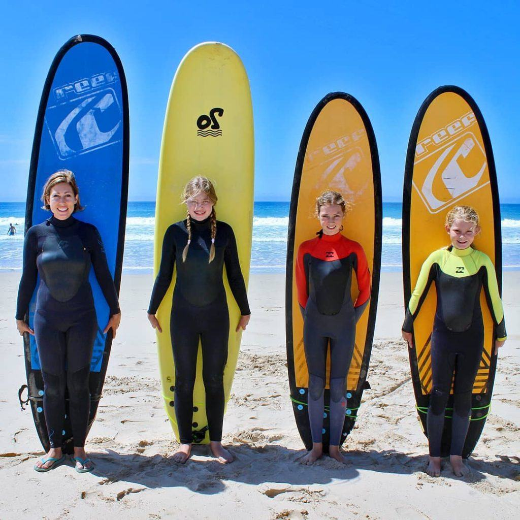 Growing Up Without Borders Chantal Patton and 3 kids surfing