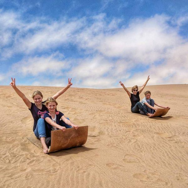 The Pattons digital nomad family, sand boarding